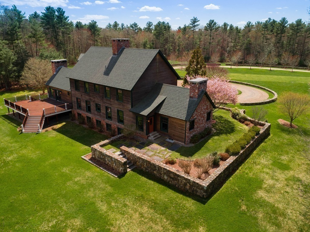 A rare opportunity to own an exceptional country estate.  Impeccable farmhouse elegance throughout this meticulously crafted custom built post and beam home.   A tree lined driveway leads to idyllic setting with 8.75 acres of gorgeous grounds and custom built stone walls. Boasting 5300 square feet of living space featuring soaring cathedral ceilings, dramatic stone fireplaces, chestnut floors, and radiant heat.  Spectacular eat-in kitchen with handmade cabinets, granite counters, large island, soapstone sinks, European style stone fireplace and French doors to a large deck overlooking the scenic back yard artfully terraced with custom stonework. A large private master suite with cathedral ceilings, beautiful stone waterfall shower, and walk-in closet.  Every aspect of this home as been thoughtfully designed and built. Located in the heart of Rochester just miles from the scenic beach towns of Marion and Mattapoisett, equestrian possibilities and proximity to commuter train to Boston.