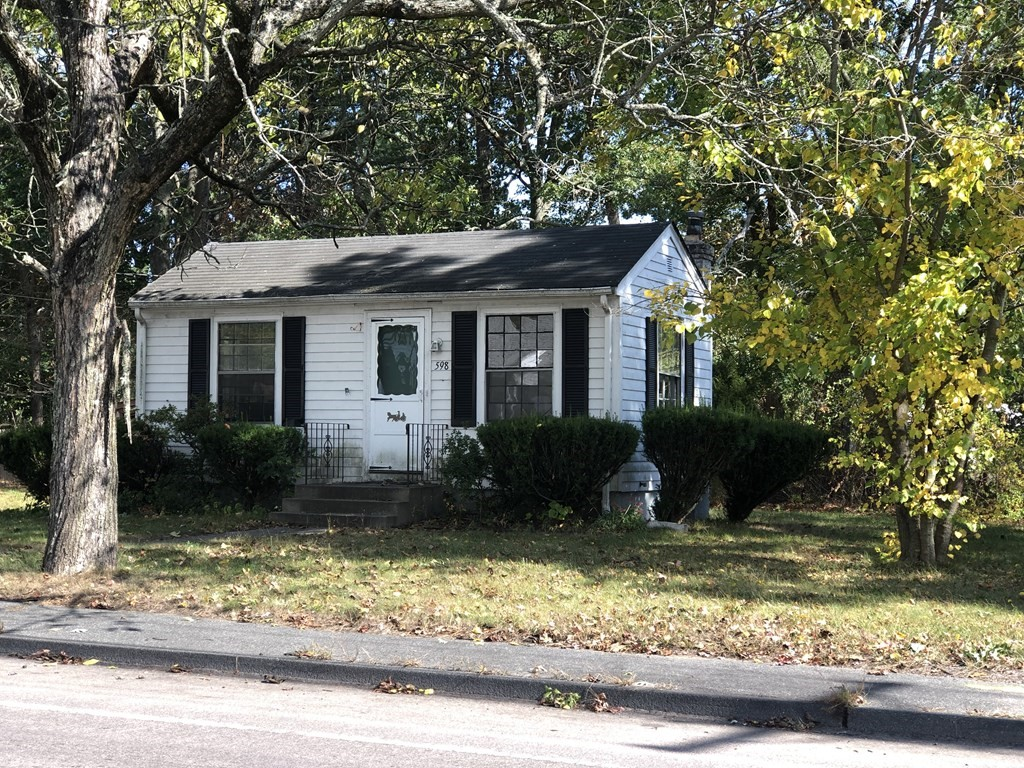 This is a great opportunity to purchase this adorable house in Seekonk! The house currently consists of a kitchen bathroom and bed/family room. There are many options here- this can be purchased for the land which allows you to start fresh and build another new structure here that fits your needs or you can renovate the existing home. There is a full basement with poured concrete walls and floor. If you buy to build your own home you will have a nice level and.68 acre parcel with no wetlands for a great price! Ne percs or septic plans completed. Call to inquire about more information!
