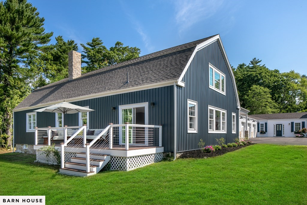 """BEAUTIFUL RESIDENCE BUILT FROM HISTORIC FARMHOUSE (1 of 2 homes on property) W/ MARION HARBOR BEACH RIGHTS. Thoughtfully renovated 1700s barn (!) w/ exceptional finishes and 3,902 sq ft of modern open-concept-style living space w/ exquisite kitchen & large island opening to dining/living great room, mudroom entry adjacent to 2 car garage, formal front entry hall, 4 bedrooms (1st fl master bedroom w/ensuite bath and walk-in closet; as well as a second 1st floor bedroom w/ ensuite bath), 3.5 baths, great closet/storage space throughout, large basement all set on a combined 3 acres of grounds w/ private and common outdoor space. This property was painstakingly rebuilt w/ the utmost attention to detail & craftsmanship. Everything in this home is new down to the studs. All new systems. Central AC. This property owns golf course 3rd hole, for which course has easement; homeowner in return has beach rights to """"Parcel F"""" behind course 6th hole. Plenty of space to work & school at home!"""