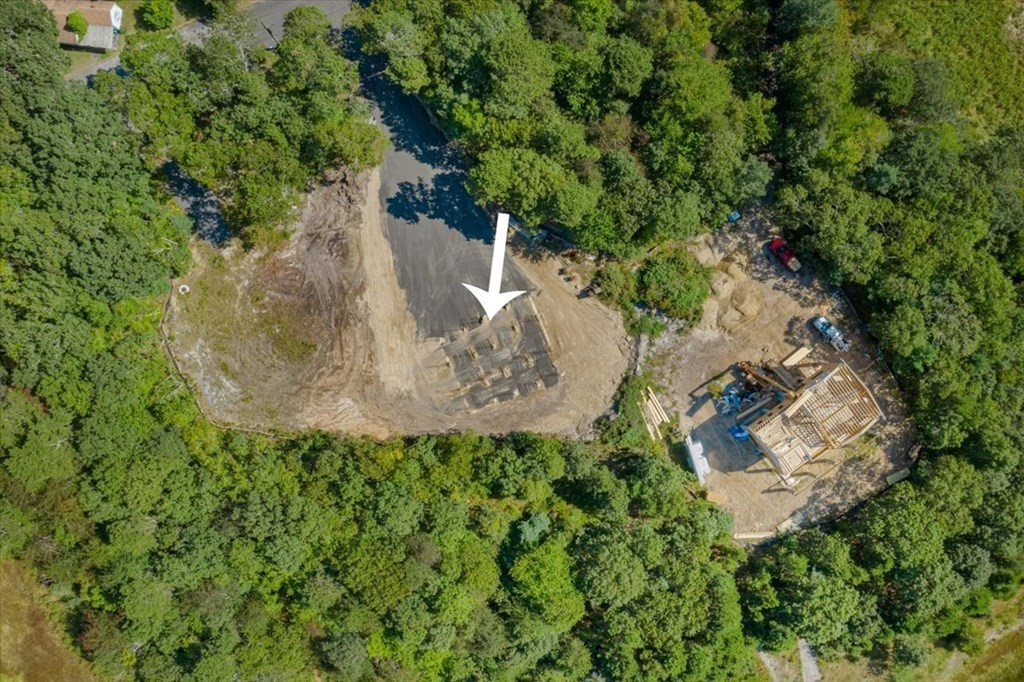 Last Lot available-Lot 11!  Interested in building your dream home with a water view?  Amazing views in every direction.  Direct waterfront on Marks Cove with water access to Buzzards Bay.   This amazing buildable lot is available with permits in hand and ready to go to build a 4 bed, 3.5 bath with 2 car garage.  Foundation is in, water and sewer has also been brought to the property-Only thing next is your ideas to build a beautiful home.  Home is permitted and plans in hand, this home is to be built on stilts. The beautiful location is only 1 hour from Boston and Providence.  Also no Cape Bridges or Cape traffic!