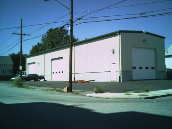 Perfect building for any of the trades - Mechanic shop, Landscaper, Welder, etc...  Oversize doors 16x14.  Heated with waste oil.  2 Bathrooms and an office.  This building comes with an extra empty lot that is 100x72 and fenced in with a rolling over sized door.  The lot is 100 feet from the building.  This listing also comes with one connex containe for extra storage.  The building has an over sized wall fan to pull out the heat during the summer months.  The building is wired with a 400 AMP service and plenty of wall outlets. The entire lot is paved.  The building also has metal racks inside for storage.  The two pieces of property are 222 and 226 in the photo of the map.