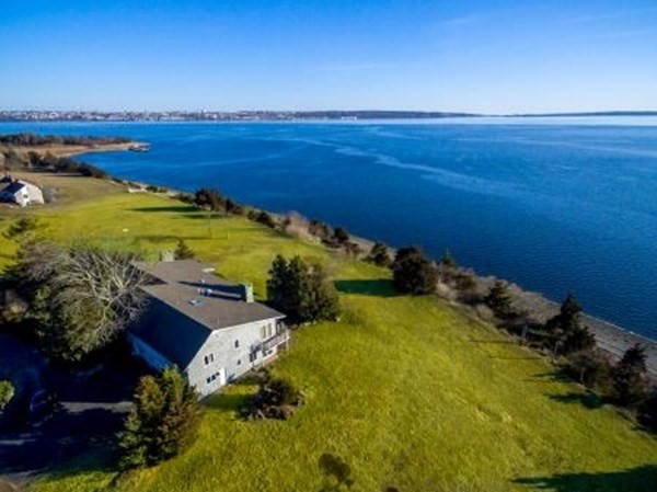 Waterfront Contemporary situated on private Bay Point road offers Mid Century flair w/panoramic southerly & westerly views of Mt. Hope Bay & the Coles River.   This one of a kind, two acre site is situated high on a bluff and has  300' of water frontage.  The architecturally designed home offers a unique floor plan including a fireplaced Living Room w/vaulted ceilings open to a Dining Room w/wet bar.  There is a large eat in kitchen,  fireplaced great room and a library/office. Master bedroom with en suite bath, 4 additional bedrooms, 3 full and 2 half baths complete the interior living space. The outside patio has a  fireplace/barbecue which will be the focal point of summer entertainment having access from the kitchen, living & dining rooms. The three car garage has ample space for your vehicles and watercraft. Marina & an optional beach/tennis club are a short walk away. This property is waiting for a new owner to restore it to its former glory. Do not walk property without agent.