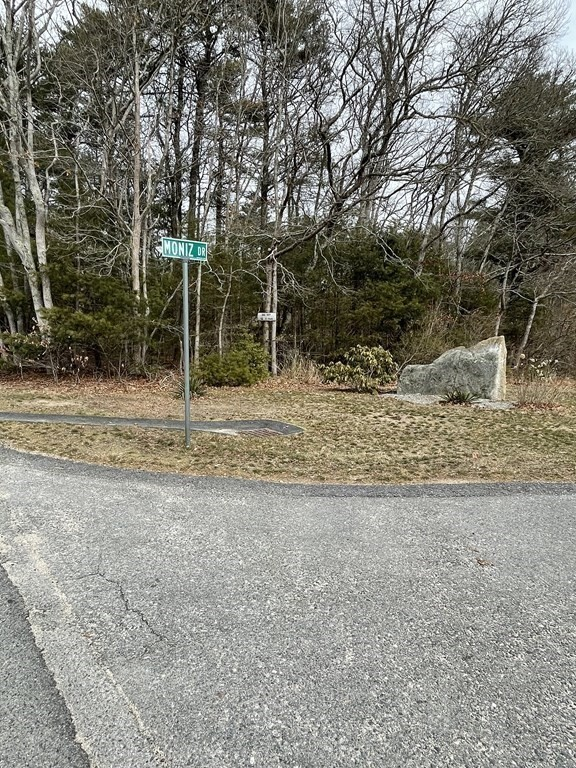 This is the last available lot on the 6-lot Pine Bluff  subdivision off Fisher Rd in Dartmouth. Create your dreamhouse and cherish quiet living at the end of a sweet country road surrounded by natural woods and privacy. Enjoy living a short distance beaches and shopping areas with access to the Dartmouth public schools. Previously perced for 4 bedroom home,  this 3.7 wooded acre lot with wetlands is a great opportunity for the right buyer.  Easement to share drive with neighbor.  HOA covers private road maintenance and common area liability insurance. For showings please call Listing agent  Roberta Burke 5084983285, or Annie Atherton 6176767621.