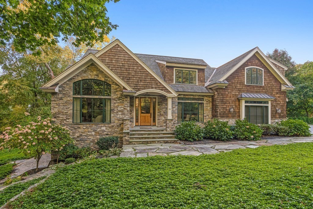 Bordering conservation, custom built shingle style home in top Myopia/ Winchester Country Club location! Designed for ease of living with direct entry garage into mudroom, 1/2 bath leading into sun-drenched kitchen/ family room spanning the rear of the home, oversized windows overlooking conservation & providing an abundance of privacy and tranquility. Top of the line finishes both inside and out with natural cedar shake roof, natural stone accents, copper gutters & high end Andersen aluminum clad windows.  First floor w/ high ceilings, family room w/ sliders to oversized deck, gas FP, formal dining room and living room with cathedral ceilings can also serve as second master suite w/ full bath! 2nd level features 4 beds, 2 ensuite; gorgeous master with high ceil, spa- like bath, 2nd fl. laundry. Full walk out lower level w/ private entry featuring full summer kitchen, bedroom, living room and full bath complete with full size windows leading to stone patio. Elevator shaft in place B-2