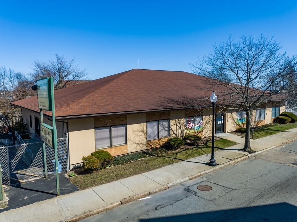 Great opportunity to invest in New Bedford, close to Downtown, highways, and the future MBTA commuter rail station. Formerly the Coastline Elderly Services center with Nearly 12,000 sq/ft  offers many possibilities. The building is currently set up with 25 offices of varying sizes, a reception area, presentation hall, several open space areas, a staff lounge, and 2 handicap accessible restrooms. ( see attached floor plan) Many walls are non structural allowing for the layout to be adapted for various needs. 50 space parking lot on a total of 3 lots( see firm remarks) with most being fenced and one having a 832 sq/ft garage. High visibility, traffic count & on the public bus route. Property is easily accessed off Rte. 18  in a designated Opportunity Zone, within approx. 50 miles from Boston, Providence and Cape Cod.