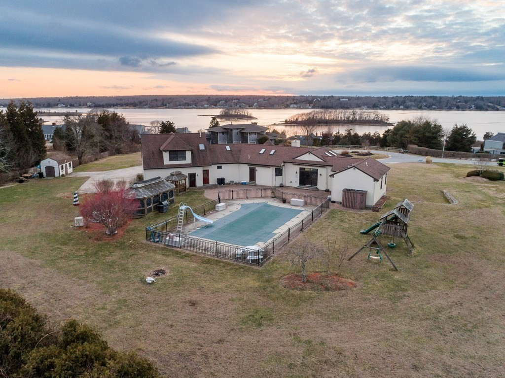 Welcome to this custom designed home. Fantastic water views and water access overlooking the beautiful and desirable Westport River! The open floor plan features cathedral ceilings and skylights throughout. Your beautiful kitchen offers cherry cabinets and granite counter tops. Enjoy the amazing panoramic views of beautiful sunsets over the river. First floor master with guest spaces on the lower level for family and friends to come and enjoy summer relaxation. The grounds offer a Gunite salt water pool, patio and gazebo!