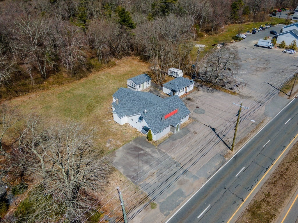 Commercial building zoned (GB) for General Business in a prime location on route 6 in Dartmouth. This property is over 3/4 of an acre and features 2 buildings. The front building is a commercial space that was once a restaurant, and the building set back off to the side is a small single family house.