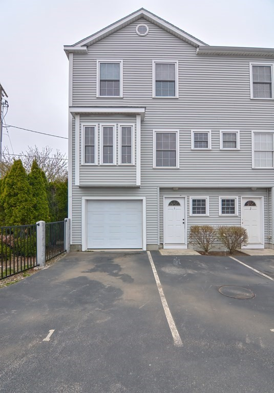 OFFERS DUE BY 12pm  4/19 - Beautiful Townhouse Condo that just may be the greatest value in Quincy!   This corner-unit condo offers three total floors! The first level has access to the garage, laundry, utilities and private back yard space that is perfect for grilling and alfresco dining.  Upon entering the second level you are greeted by a bright, spacious, open floor plan.  Here, the kitchen overlooks the versatile living room and is complete with a 3-seat center island, granite counters, stainless steel appliances, and garbage disposal. The half bath is conveniently located here as well.  And the third level comfortably homes two bedrooms and the full bathroom.  Both full and half bath have granite counters. This beautiful condo has custom blinds and hardwoods throughout, low HOA fees, a one-car garage & two additional deeded parking spaces, pet friendly, & conveniently located just a short distance to the highway, Downtown Quincy, MBTA, bus routes, shopping, restaurants, & more