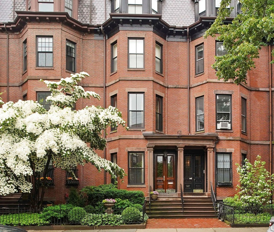 This showcase townhouse in the heart of Back Bay has been completely renovated and impeccably designed to create the perfect combination of modern conveniences and historic grandeur. A private elevator serves all five levels of the home, which are topped by a full stair with motorized glass door hatch that opens to the spacious private deck with panoramic city views. The elegantly appointed interiors include 4 bedrooms and 3 full and 2 half baths with the entire third level dedicated to the Master and a full suite on the garden level ideal for au pair or guest use. Features include a beautiful custom eat-in kitchen on the parlor level, oversized formal living and dining rooms, 7 elegant fireplaces, bay windows on the front and rear facades, sophisticated millwork throughout, a home gym or bonus room, a suburban sized laundry room, and a mudroom connecting to the home's landscaped garden and two full side-by-side parking spaces.