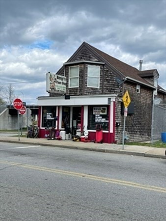 Mixed-use retail and residential property. First level is currently rented to a Pawn Shop. Second floor is an updated two bedroom townhouse set up. Newer updates back in 2016 including roof, insulation, electrical and replacement windows. Great opportunity to operate your business and have rental income. Rents are low due to long term tenants. Buyers agent to do due diligence.