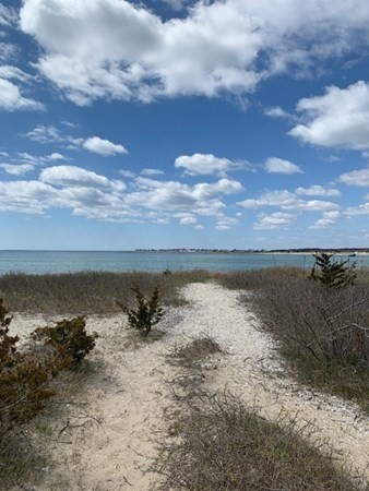Rare Find !!  A water view dream lot of Nasketucket Bay on West Island. Located near breath taking beaches with miles of walking for nature lovers. West Island is located in Fairhaven, an hour south of Boston, between Providence and Cape Cod. Enjoy watching picturesque sunsets and living life on the Island.  A real slice of heaven !!  Some approvals or variances might be needed, but definitely worth the effort. Property is being sold As-Is. Lot is adjacent to Pole #299/31. Use your imagination and make this a great place to call home.  Don't miss out on this one !