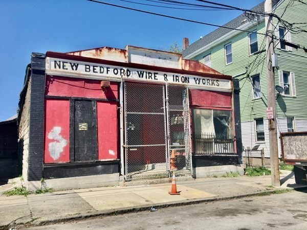 Huge 3,400 sq. ft. commercial building with off street parking with potential for many possible uses.   Building will be cleaned of all debris inside....