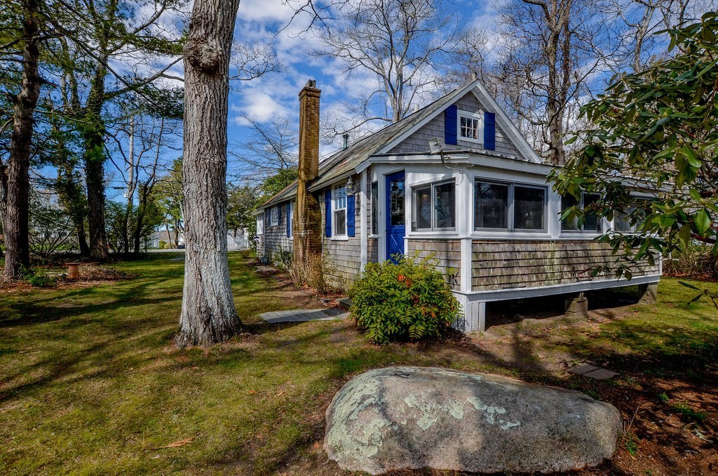 Adorable year-round cottage with waterviews of Aucoot Cove and outer Sippican Harbor. Deeded beach rights at end of Taunton Ave (one house away). Enjoy as a darling vintage cottage with sleeping loft in the attic or remodel to take full advantage of the views. Mature plantings on lot and nice options to add a car turn around and patio as well as a private yard. Sandy beach at the end of the road, with lovely views of the harbor out to Buzzards Bay. Mooring may also be available (consult Marion Harbormaster). Owners are developing a proposal to subdivide #3 and #12 Taunton Ave to create two separate lots. Completed sale transaction is contingent upon town of Marion approval of subdivision plan. All final data per lot size and tax information pending subdivision.