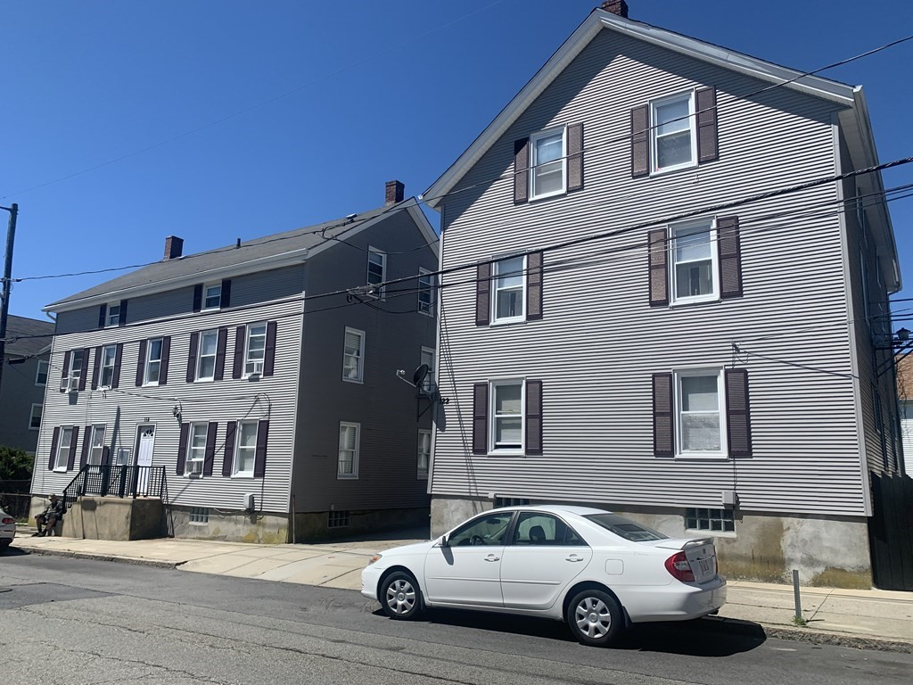 8 units, 2 buildings side by side. Large, fenced yard with small driveway. All units are occupied, below market rents, long time ownership. Plenty of upside potential for a seasoned investor.