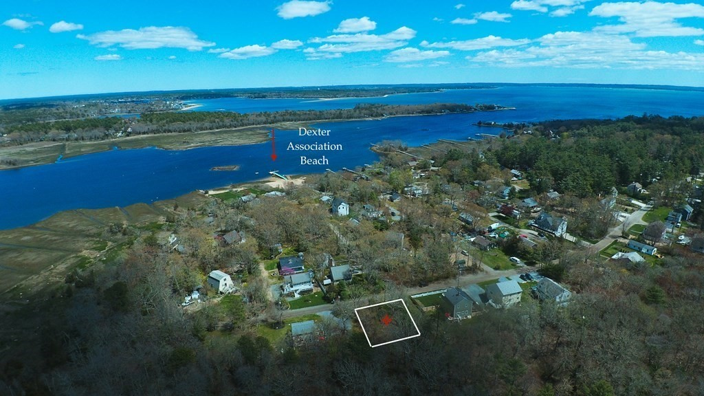 Welcome to the Dexter Beach community in the seaside town of Marion. Buildable lot with connection to town water and sewer at the street. This community enjoys access to an association dock, swimming raft, sandy beach, playground and picnic area. Parcel is located between two  established homes and is a short walk to the beach, offering easy access to Buzzards Bay. Perfect for relaxing sunbathing  boating and water craft activity. The lot is located in a Flood Zone , buyer to do their own due diligence.
