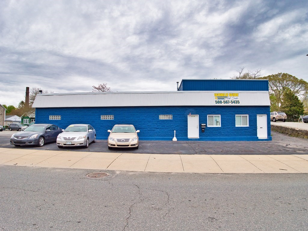 Large autobody shop with 75 car parking lot and buildable lot for sale. Massive 2 floor building with modern office and accessible attic and basement for additional storage.