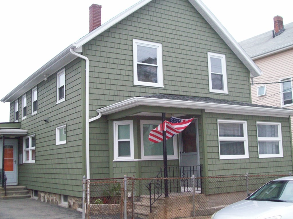 FALL RIVER-2 family, second floor is completely gutted, ready for your personal touch, first floor is a 3 bedroom, living room, dining room, kitchen, bath, 4 season sunroom, off street parking, 2 garages, good size yard, lots of potential. Will not pass FHA financing.