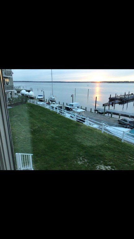 Beautiful and Spacious updated, waterfront condo Granite countertops and Hardwood floors throughout. Central air and Fireplace Balcony Washer and dryer in Unit Garage Pool and Gym Free water (no water bill)