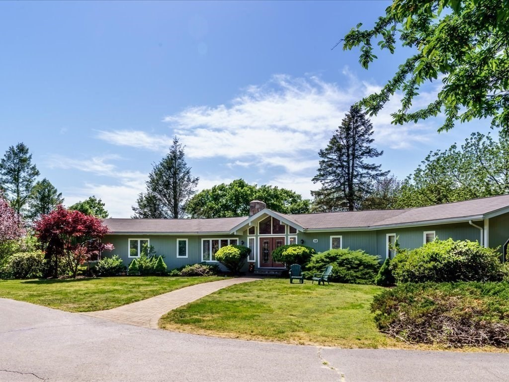 Beautifully Maintained over 3,000 Sq.Ft. sprawling Ranch style home on 2.38 acres set back off the main road with a circular drive.  Open living area offers Living/Dining with central Fire place and access to out door deck and patio area.  Kitchen has been updated with Granite counters,S.S. appliances and large center island.  Lovely master bedroom suite w/ updated master bath, walk in shower, and double sinks. Slider off the master leading to your own private sun room for enjoying the scenic views and nature. Fully finished lower level  for In law/additional living area. Separate entrance to your own private patio area.  Large family room with Pellet stove, laundry, full bath with updates, and large 3rd. bedroom with huge closet.  Outdoor amenities include a patio with hot tub. Walkways to the pastoral setting that includes a Gazebo with water and electric, matured fruit trees, perennial gardens, and a large detached garden shed. Located minutes to Golf and highway access.New septic.
