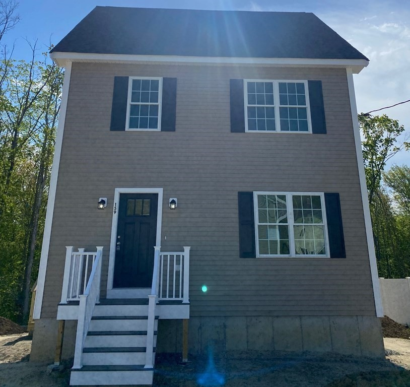Brand new, custom colonial home in the highly sought after Highland Woods subdivision. This home is constructed on a 12,318 sf lot that backs up to the woods/conservation land behind it.  The home is a total of 1,600 SF with 3 bedrooms and 1.5 baths. Granite counters in kitchen and full bath upstairs, Kohler pedestal sink in half bath downstairs. Full Bath upstairs has an oversized single vanity, a custom granite bench with storage below, as well as an alcove tub and subway tile surround and a toilet. 2 bedrooms on the second floor, one larger bedroom on the third floor.  Hardwood floors in main living areas, porcelain tile in bathrooms, carpet in bedrooms.  Contact the listing agent or list office to schedule a showing, this home won't last long!
