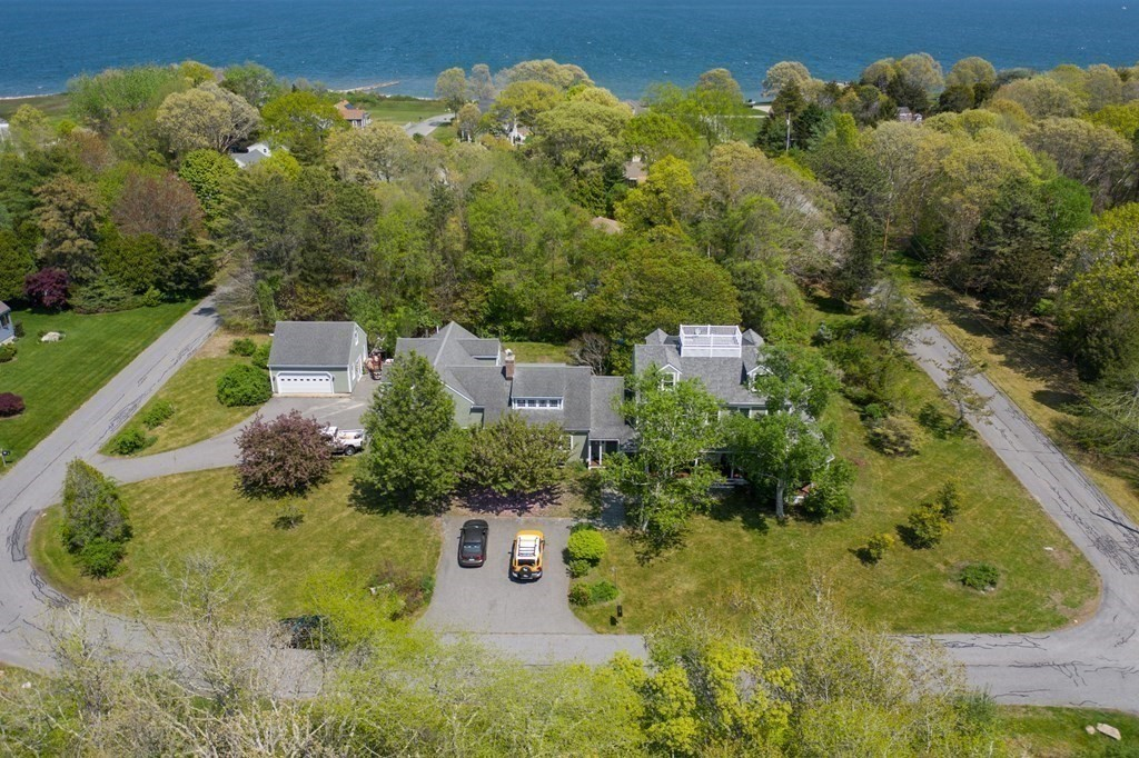 This beautiful home is located in the highly desired private community of Hollywoods.  Take a short walk to the private beach where you can soak up the sun or head out to your mooring to enjoy your boat in Buzzards Bay.  This New England style home features six bedrooms and six bathrooms with an attached three car garage and a separate two car garage.  When you arrive you will fall in love with the mahogany farmer's porch with luminous lighting that wraps around to the back of the house.  As you tour this home you will see an open floor plan that is perfect for entertaining.  The great room has soaring vaulted ceilings with light drenching skylights, and a wood stove fireplace for those cozy winter nights.  The guest quarters/au pair above the three car garage is a must see!  Take advantage of all the things this seaside town has to offer from golfing, walking trails, and all the great local restaurants.