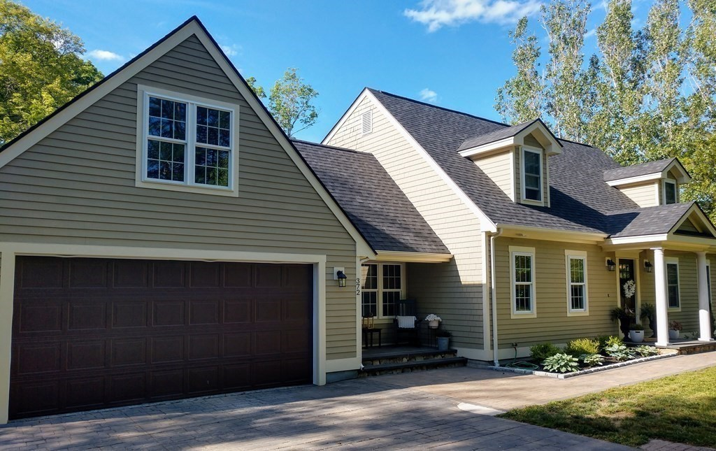 Are you looking for privacy, yet convenience to highways?  Then, this beautifully updated 2-3 bed, 3 bath home with attached 2 stall garage tucked away on a picturesque lot complete with a fish pond and surrounded with stone walls is for you!  This home boasts a cute entry/mudroom,  an open floor plan with an updated kitchen, dining area with slider to a newly rebuilt deck, living room with columns and built-ins, hardwoods throughout, and a newly updated bath on the 1st floor.  Walk on upstairs to find another awesome built in, new hardwoods,  renovated front to back master bedroom with walk-in closet, updated bathroom, cute front to back second bedroom with sliding barn door that leads to a bonus room over the garage with new laminate flooring and lots of closet space.  Need more space or a possible in-law?  Head on down to the walk out finished basement and find a family room with bar area and slider to a patio, bonus room, full bath, and closet! New roof, dormers, windows, & more!