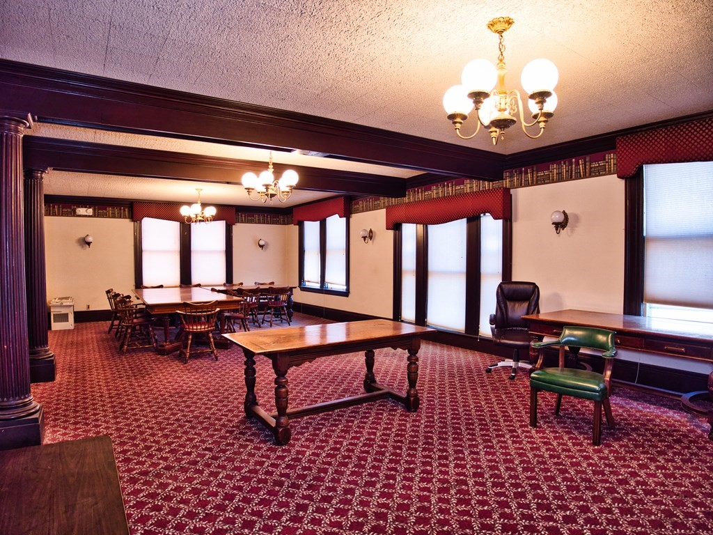 Here's your chance for a great office space! The office is 37x18. With elegance through chandeliers, a fireplace display and oversized windows, you will have the office of a true CEO. Electricity and heat included in the rent. Shared bathroom in the hallway and signage options throughout the building!