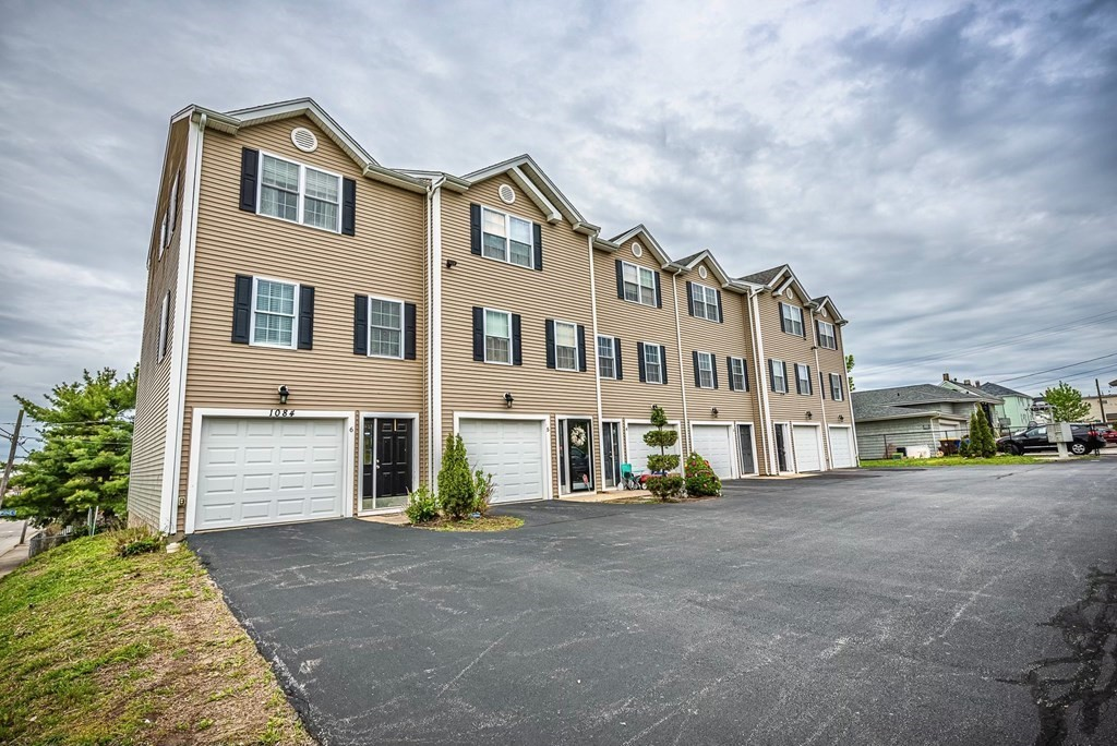 Welcome to Hill Top Condominiums!  Pride of ownership is displayed throughout this TURN KEY townhome leaving you nothing to do but move in!  Features include an open floor plan design, living room w/ GAS FP, updated kitchen with granite and SS appliances, recently renovated full bathroom, nice size pantry, updated 1/2 bath on main level, garage, storage area, in-unit laundry, 2 zone GAS heat, central air, & more!  Did I mention this association is PET FRIENDLY (w/ a dog park across the street), offers off-street/assigned parking for up to 3 cars, has a LOW condo fee, & is conveniently located minutes to shopping & major highways!!  Open House Friday 6/4 from 6-7 p.m. & Saturday 6/5 from 1-3 p.m!