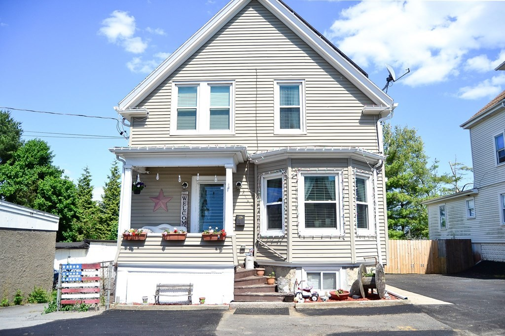 Welcome home to this oversized cottage. This home features a open floor plan on main level kitchen, living room, dining room  laundry room and  half bath second floor features a sitting area,  three good size  bedrooms and a full bath. 2 Zone central air, 2 Zone heating solar panels and 10 garages that 9 are collecting rents of $100 per month and 1 at $175 a month  Great Dartmouth location; convenient to public transportation, shopping, park, golf course, medical facility, Laundromat, bike path, House of Worship, marina, public school, university, highway access. This home is a must see!