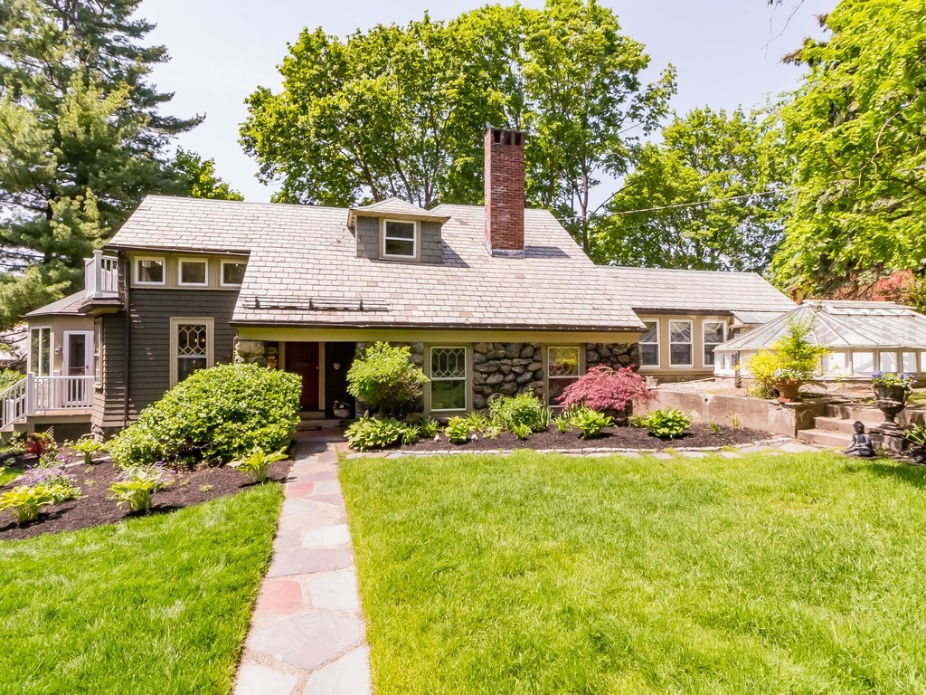 Set on one of Watertown's prominent tree lined streets in the sought after Oakley CC neighborhood, this 1900 home was designed by renowned architect Charles Brigham. Privacy abounds as this home sits on the rear of the 15,000+ lot. Step into the enchanting secret gardens w multiple trellis's and garden areas w/grapevine which leads to the charming stone bungalow. Major renovations and an addition in '98 almost doubled home in size. Be amazed by the stunning hand painted mural of Italian countryside in the entry! Large fpl livingroom w 12' ceiling is perfect for relaxing. The cozy home offers 2 master suites, one on 1st flr w its own romantic solarium, & full bth, the other on the 2nd flr with a 2019 bathroom with clawfoot tub overlooking landscape. The combo kitchen, dining also has a vaulted ceiling family rm surrounded by windows. Enjoy the steam room & half bath off the bonus room. 2 garage spaces w storage and pking for 8+. Minutes to Camb+Boston. Any offers reviewed Wed June 9 2pm