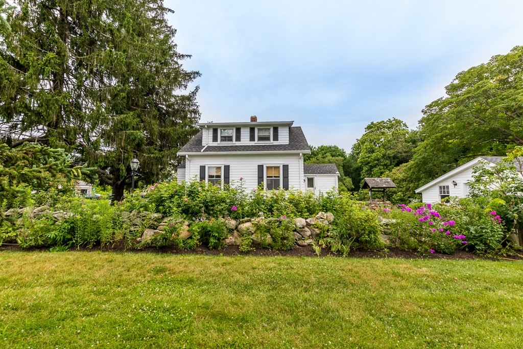 This much admired quaint cottage with its roses, perennial gardens, and stonewalls is ready for a new owner. Lovingly maintained by the same family for over 80 years, this move in ready property shows off period details in its woodwork and beautifully resurfaced wood floors. Upgrades include upgraded bathroom, new well, new septic system. Enjoy the easy flow of the kitchen, dining, living room. The workshop area in the one car garage is a plus. The backyard extends to another stonewall. Only organic products have been applied to the yard and gardens. Located close to Central Village, shopping, highway access, and beaches. What is your goal? Downsize? First Time Buyer? Snowbird with roots in town? Rental property investment? Commercial space? This could be the perfect answer for any one of those goals.