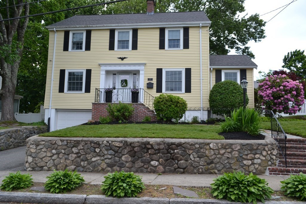 Center Entrance Colonial in one of Arlington's prettiest neighborhoods! From the moment you enter the front door you'll notice the beautiful wood work throughout...Front to back living room with recessed lighting & built-in bookcases, gas fire place, formal dining room with built-in hutch, thoughtfully upgraded granite kitchen with stainless steel appliances & separate pantry with bonus sink area for coffee & entertaining.  Additional first floor home office/play room with glass pocket door & slider to the back yard. Second floor has three bedrooms, including a master bedroom with new bath & skyline views of Boston, renovated main bath & a bonus office area. Walk-up attic for storage or expansion potential if needed. Finished family room & one car garage parking with direct entry on basement level. Landscaped fenced-in level yard, patio and shed for storage. Newer windows, roof, gas heating, sprinkler system and more! Steps to Robbins Farm & Brackett School! Easy access to Rt. 2 & 128!
