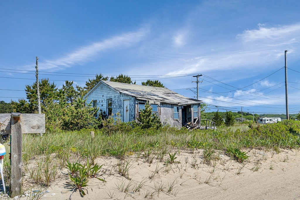 Land for sale steps away from Horseneck Beach. 1/4 of an acre. Buyer/Buyer Agent must conduct their own due diligence. No entry into house. Sold as is with no warranties or representations. Cash buyer only. Offers if any due 6/23 at 5 pm, decision by 6/25.