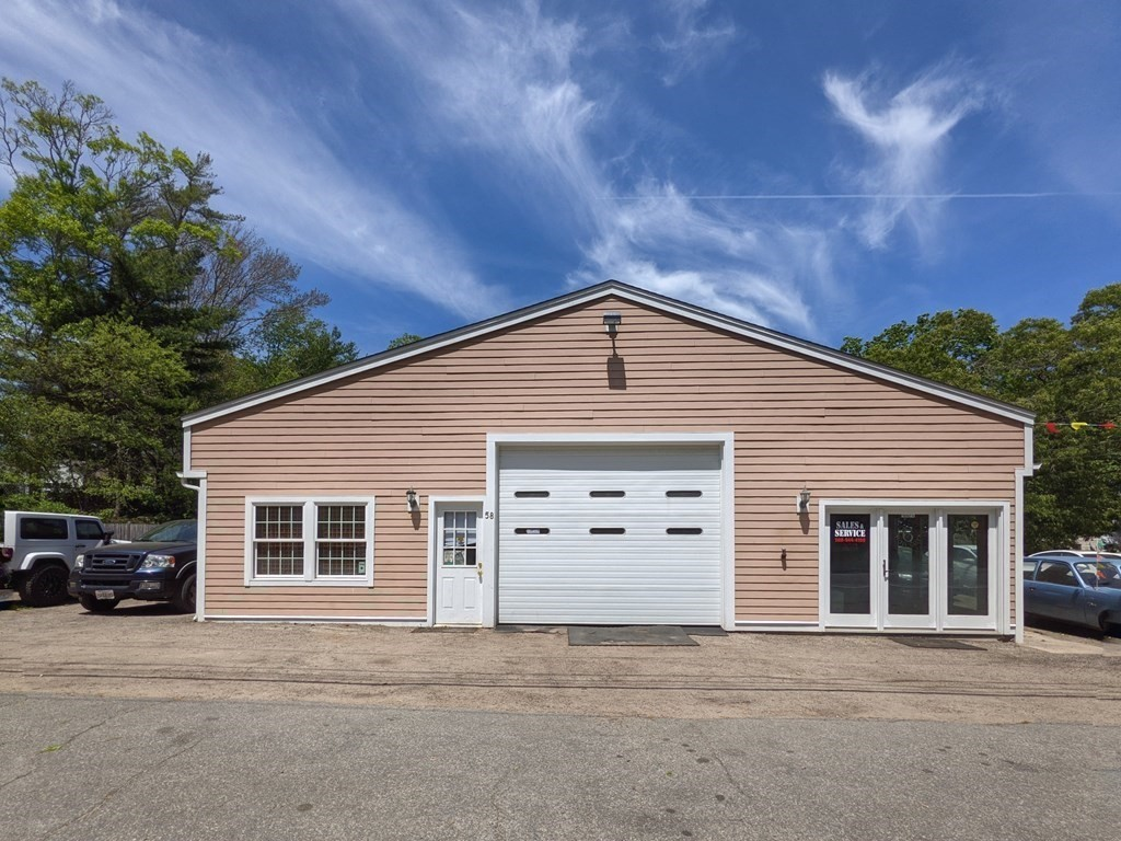 Opportunity knocks at this downtown location! Property is currently used as an auto sales & service garage w/a license for 23 vehicles. High traffic count & upfront visibility for passing vehicles with 150 feet of frontage on busy Sandwich Rd! Lot is just over a half acre, is partially fenced and has an additional 150 feet of frontage on Pires Ave.  The building has an inviting reception area w/plenty of room for seating. Easy entry to the service area through the oversized 10x12 garage door & a second garage door off the back for convenient drive through access. Shop area is spacious and has a clean burn waste oil heater, exhaust fan, 12 ft ceilings & overhead led lighting. Equipped w/a Dayton industrial air compressor & a Rotary lift that can remain if buyer would like. Theres also a storage/utility room, full bath & a bonus room above the garage. FHA heat by oil, town water/sewer, seller will tie in to sewer prior to close.Zoned strip commercial. Vehicle inventory is also negotiable