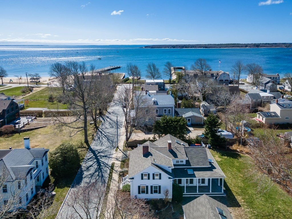 Steps from Mattapoisett Harbor & the town beach, proudly sits this expertly renovated 1850's Sea Captains House in Mattapoisett Village. Ready for immediate summer fun, this turnkey property boast's a large, white, sun-filled chef's kitchen w large island and top of the line appliances. The kitchen is open to an oversized family room w fireplace,  built-ins, & french doors opening to the deck & enclosed backyard.  A charming living room & dining room w fireplace & large mudroom w laundry complete the first floor. Upstairs there are three bedrooms with ensuite master bedroom w balcony & water views. There are gorgeous antique floors throughout w/renovated bathrooms & new systems to include electric, plumbing, heating & central a/c. Stylish w/high quality craftsmanship, this is a superb location on lower North Street allowing you immediate access to the town wharf for boating and swimming at the town beach. Turnkey.