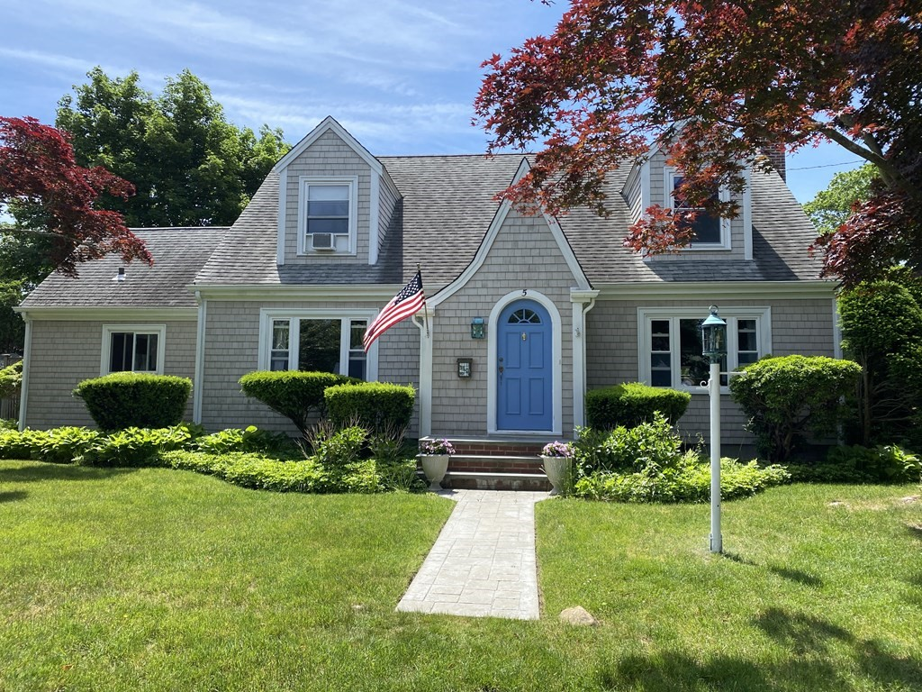 Padanaram gem! This 2,126 square foot 4 bedroom, 2 bath home has storybook curb appeal and is set on a corner lot with mature trees and surrounded by similarly maintained properties. Enter the arched front door to find a delightfully spacious first floor interior to include a front to backfireplaced living room, dining room, updated kitchen, master bedroom, full bath and office with separate entrance. Travel up the double sided staircase to find 3 additional bedrooms, full bath and sitting room. Other features include hardwood floors, built-ins, period details, wooden deck with hot tub off the kitchen and detached 2 car garage.Add to all the charming details the fact that you will also have deeded beach rights to Stoneledge Beach and you'll have yourself an eye-catching Village home. Minutes to downtown Padanaram Village with shops, restaurants, New Bedford Yacht club and harbor...