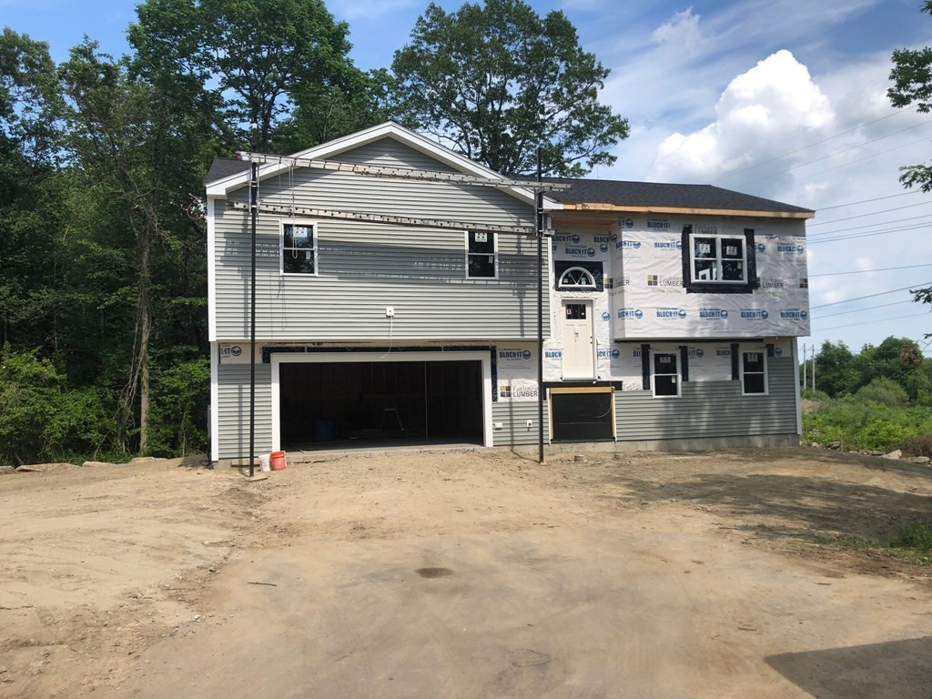 Brand New Construction on Private Roadway in the heart of Acushnet. This Beauty is near completion. This home is open and spacious with 4 BR/3Baths/2 Car Garage. Experience your Open floor plan....Cathedral ceilings in the living, dining and kitchen areas overlook conservation land and located at the end of a private road is just what the doctor ordered.  Peace and Tranquility at its finest!  This small private roadway is designed for 3 single family residential homes. Fully finished basement listed as 4th bedroom could easily be a fantastic home office with its own private entrance and full bath. Finished 25 x 25 Garage ample room for 2 vehicles plus storage. Video Surveillance on site-Please do not walk or enter property without listing Agent. Estimated Completion End of July.