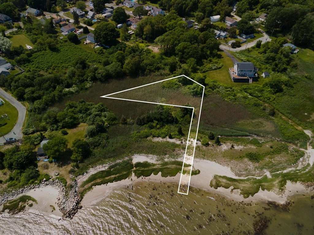 """Potentially developable land in Priests Cove neighborhood of Fairhaven.  Buyer(s) and their agents should perform due diligence to verify the usability.  Town lists property as """"potentially Developable"""".  Photos and lines drawn are an approximation."""