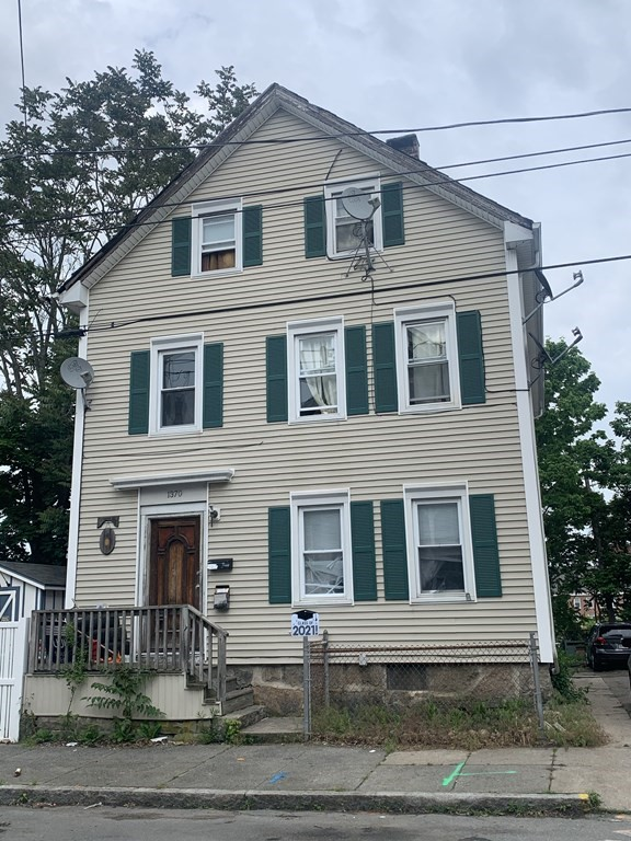 First floor is a 2 bedroom, second and third are a 5 bedroom townhouse style unit. Both units are occupied. Lots of off street parking!