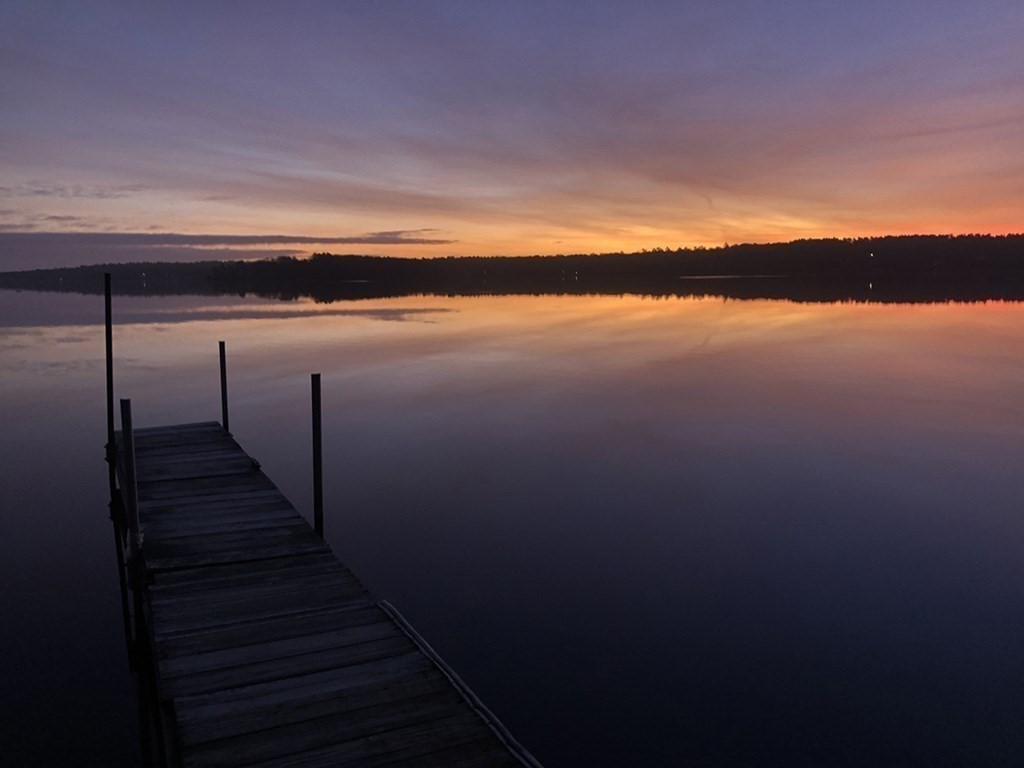 Lake Life Awaits… Swim, Boat, Fish, Kayak, Float, or Anything Else Imagined,  Steps from Lakeville's Long Pond This Breahttaking Waterview Home w/ PRIVATE DOCK.  This 1,000sf (plus a 300sf Sleeping Loft ) 2 Bed / 1 Bath Fully Renovated Custom Rustic Cottage Leaves No Stone Unturned & Only Steps to Private Nghbhd Beach. From the New Board & Batten Siding to the Fully Hand-Crafted Shiplap & Reclaimed Trim on the Interior You Will Not Be Disappointed. Complete, but not Limited to the Following; Private Neighborhood Beach with over 700' of Water Frontage and Boat Ramp. The Home is also Complete w/ Hardwood Floors, New Shaker Style Kitchen w/ Farmer's Sink & Stainless Steel App Suite, Washer/Dryer, Custom Tile Bath w/ Antique Vanity, New Heat/AC, Lighting, Electric, Generator Connection, Plumbing, Windows, Roof, Insulation, Paint In&Out, Septic & So Much More. Exterior Features Include New Well, Private Lot, New Deck, Outdoor Shower, 1-car Garage Plus an Addt'l Storage Shed...