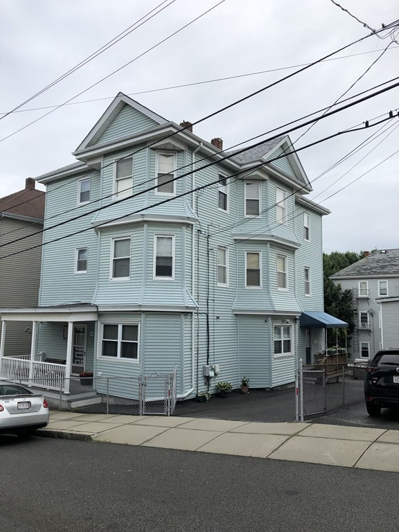 Perfect opportunity to own in Fall River. Conveniently located near Routes 79 and 195, close to downtown and minutes away from the proposed South Coast Commuter Rail and more. The first floor owners unit has a formal dinning room and pantry kitchen including a built in microwave , range and refrigerator, 3 good sized bedrooms, laminate and tile flooring and baseboard heat. The second and third floor units both offer hardwood flooring, 2 large bedrooms and double parlors and a formal large dining room and pantry kitchens. The basement offers washer/dryer hookups for all units. The exterior of the home offers vinyl siding and custom canvas porch coverings some trex and pressured treated decking as well as off street parking currently used by the sellers. First Showings Wednesday June 16th , 5:00pm-6:30pm, appointment required.