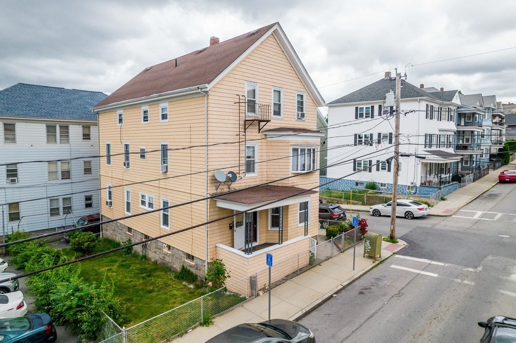 Great opportunity for an owner occupant or investor! 4 Family featuring 1-1 Bedroom unit 1-2 Bedroom Unit  2-3 Bedroom Units. Group Showing 6/19 12pm -1pm