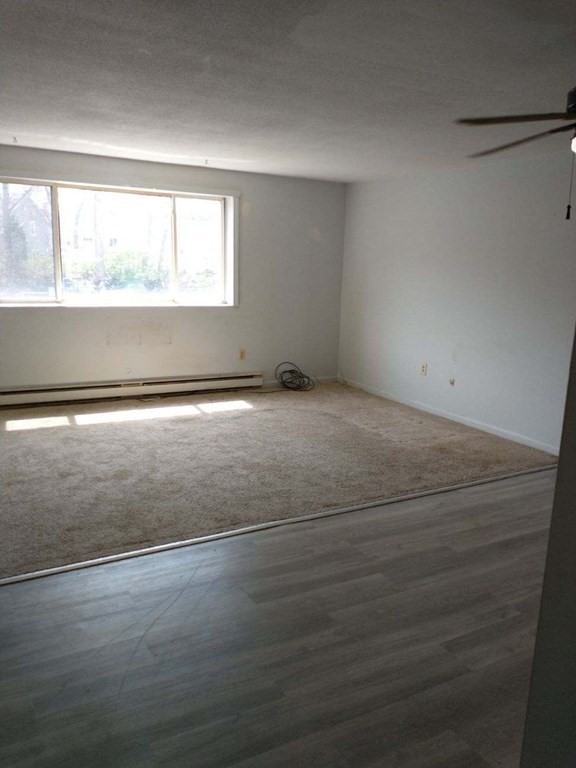 Lovely corner unit in desirable Duxbury building! Carpet and flooring new. Great investment property, rents for $1,100 a month. Buyers and buyers' agents to verify all information. Information deemed reliable but not guaranteed.