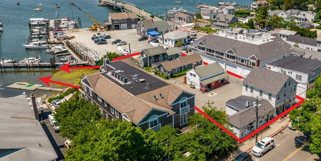 """Once in a lifetime opportunity!  Nestled on the water in the heart of Padanaram Village. Padanaram Harbor in South Dartmouth was voted Best Harbor Grand Winner in 2019 and Northeast Regional Winner in 2021 by the 4 million users of USHarbors.com. This iconic piece of mixed use, commercial/multi-family property has been owned by the same family since the1960's.  Property consists of 2 commercial units and 7 residential units with direct waterfront access. This property is perfect for a developer who has a business vision. Flood insurance is assumable. Pre-approval letter/proof of funds required prior to all showing appointments. Buyer/Buyer Agent is responsible for all due diligence. All tenants (both commercial and residential) are """"at-will"""" tenants. Property is being sold """"as-is."""" DO NOT DRIVE IN TO THE BACK OF THIS PROPERTY. It is also listed in MLS under Commercial, MLS#72851153 .***** Please view the attached video and diagram."""