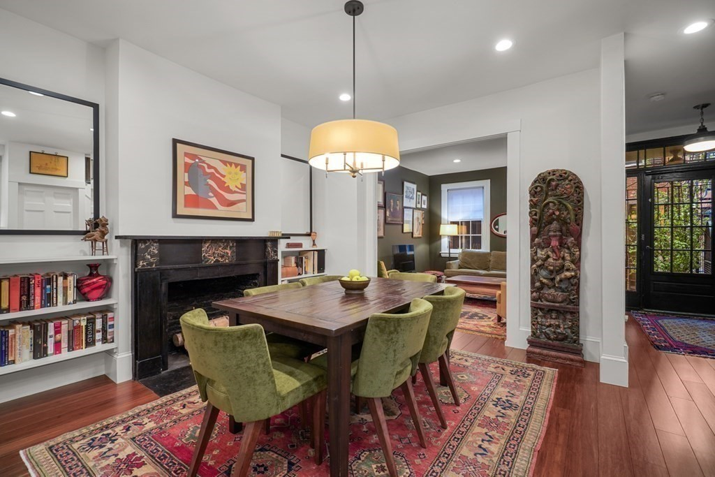 An oasis in the city! Totally renovated in 2018, this rare single family townhouse is tucked away on a private brick courtyard in Bay Village with parking at your front door. The gracious floor plan provides the sought after kitchen, dining and living on one level, with a convenient half bath. The kitchen is a cook's dream with custom cabinetry, Taj Mahal Quartzite counters with leathered finish, gas cooking (Bertazzoni range) and Fisher Paykel refrigerator. The kitchen leads to inviting dining room with original marble fireplace. The front living room is a wonderful place for guests and overlooks the brick courtyard. The second floor guest level has two bedrooms, an additional family room with fireplace,  and a beautiful all tile bathroom with Porcelanosa fixtures. The top floor master suite includes a sitting area and walk-out Ipe wood deck overlooking Elliot Norton Park. The basement provides great storage and laundry area. Three zones of heating and a/c. Tankless hot water system.