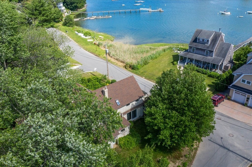 This is it! Love the ocean, boating, kayaking, paddle boarding or just enjoy watching the parade of boats go by? Here is a very rare chance to  renovate, remodel or re-build your own seaside home!  Total unobstructed views. Over 1/4 acre of a level lot corner Lot. Check out what the neighbors are doing with their homes. Wake up to amazing water views and ocean scent everyday. Right of way for water access and to Bailey Beach.  Property has two parking areas, public launch area across the street. Moring availability and application are in documents. All offers due Tuesday before 6pm. Sellers will respond Wednesday by 1 pm. See remarks section. FOLLOW OFFER INSTRUCTIONS & COVER SHEET MUST BE USED. SEE CLIPBOARD.  DO NOT WALK ON PROPERTY.