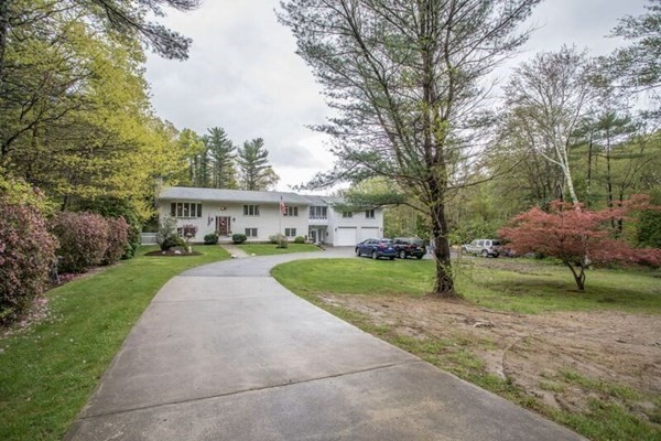 BACK ON MARKET DUE TO BUYER FINANCING!! INSPECTION AND APPRAISAL WERE GREAT.   INLAW anyone!!   Well maintained home perfectly set back on over 1,65 acres of wooded splendor.Beautiful home privately set on cul-de-sac. Home features to much to list, 5+ bdrms, 3 full baths, huge mud rm, screened in veranda, 3 season rm, granite counters, water filtration sys, hardwood flrs,central air, bonus area for in-law. Bonus 1,400 sq ft (not in GLA) of finished space in lower level featuring pellet stove, electric fire place, family rm, 3 bonus rms, 4th full bath, laundry rm and interior access to 2 car garage. 28ft above ground pool,with new pump.  shed, brick front exterior, roof is 12 yrs old, Anderson windows and passed Title V. Whole house generator that is 4 years old. Handicapped chair lift that is only a few years old.