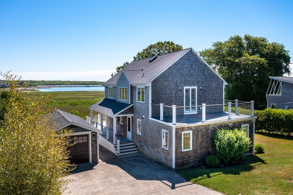 Welcome to the year-round coastal community of Mattapoisett's Brant Beach and to this updated 3BR/3BA home with panoramic views and a set-up ideal for enjoying life at the beach. This home has been well-cared for with many recent updates including a major renovation when it was purchased, and then updated flooring, windows/doors, siding, roof, furnace/hot water, most bathrooms, central AC compressors, Ipe decking and railings, outdoor shower, and updated garage that doubles as a bunk house (plumbed for ½ bath). A comfy living rm/dining/kitchen flows to a wrap-around deck with breathtaking views. A rear den offers privacy for guests or home office. There's a 1st fl bedroom and adjacent full bath. The 2nd floor vaulted primary bedroom has an ensuite, walk-in closet, loft area and its own balcony. Brant Beach is a charming neighborhood Association with one of the most beautiful beaches in town. This home is turnkey and all that's left for you to do is move in. Town sewer. Private well.
