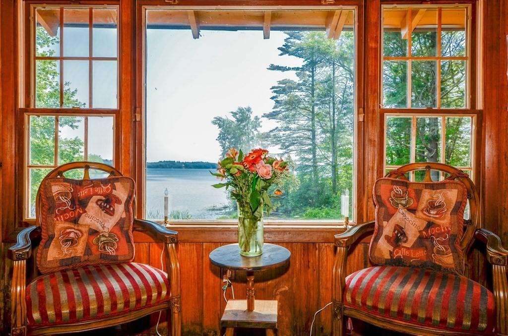 Sunrise on Snipatuit Pond anyone? Imagine living in an authentic log cabin cottage on the pond's shore, surrounded by 20 private acres of woodlands and abutting working cranberry bogs. Old stone walls mark the property line on Snipauit Road and promise unspoiled acreage beyond for hunting, fishing and quiet solitude. The main living area boasts a beautiful fieldstone fireplace, open living room and picture window overlooking the pond. The main bedroom offers equally attractive views on the same level. The kitchen is tucked into the rear of the house with its own screened porch facing the backyard. A larger screened porch faces the pond offering a wonderful morning coffee spot and a delightful setting for evening cocktails or tea! The lower level of the home holds a garage, office, storerooms and another bathroom. The well has been tested and found to meet town of Rochester requirements. This is a very private, unique property that can be enjoyed as is or further developed.
