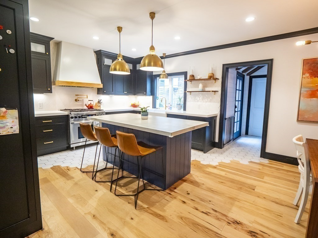 Rare opportunity to own a free-standing single-family home in Southie that was carefully renovated in 2016 by a local design/ build team, with hickory floors throughout and high-end lighting and fixtures that complement one another throughout the entire house. Perfect for entertaining, this home features a custom-built chef's kitchen with ample storage, professional appliances including a Sub-Zero refrigerator and freezer, kitchen island with wine fridge and dining area. Off the kitchen is a rarely seen in the city mudroom with custom built cubbies, a powder room with a beautiful Carrera marble waterfall sink over a custom-made oak vanity, and a large coat closet, all opening up to a beautiful professionally designed and landscaped patio that encompasses both a dining space and a lounge area, a well-maintained garden with fruit trees that bloom year after year, and a vegetable garden that has been growing strong for decades. This house is truly a hidden oasis with a suburban feel.